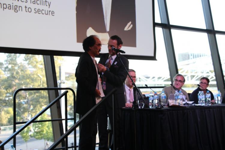 Simon Chu receiving the distinction of Fellow of ICA from David Fricker, ICA President, ICA General Assembly 2019, Adelaide, Australia